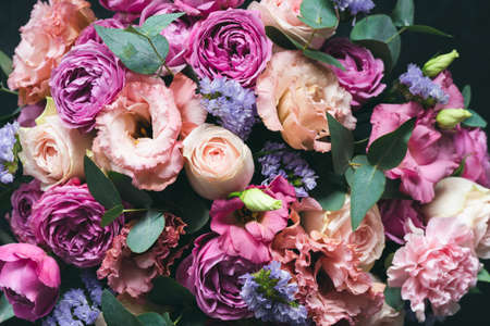Beautiful pink and purple Peonies and roses bouquet with eucalyptus. Closeup view. Wedding or Birthday bouquet of flowers