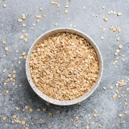 Rolled oats in bowl, healthy food, healthy eating concept.