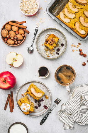 Breakfast healthy pumpkin apple cake or pie with oats, walnuts and dried cranberry