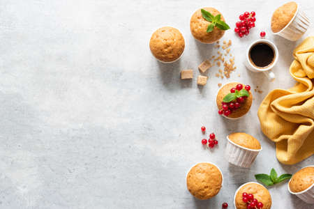 Fresh muffins or cupcakes with paper cups.