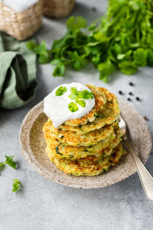 Zucchini fritters with yogurt sauce and cilantro