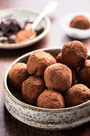 Chocolate truffles coated in cocoa powder. Homemade chocolate candy in bowl Reklamní fotografie