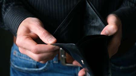 Empty Wallet In Male Businessman Hands. Bankruptcy Concept, Financial Crisis, No Money