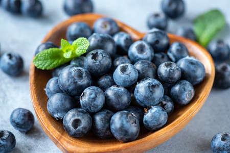Fresh organic blueberries in a bowl closeup view Stockfoto