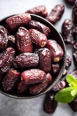 Dried Medjool Dates In Bowl Top View Closeup. Healthy Vegan Food, Islamic Arabic Ramadan Food concept