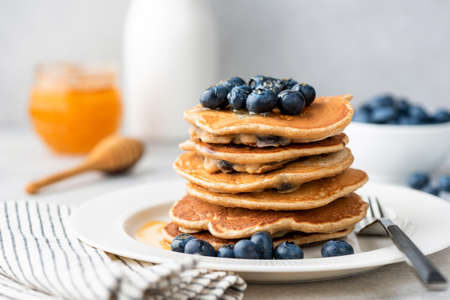 Homemade pancakes with blueberries. Stack of tasty pancakes