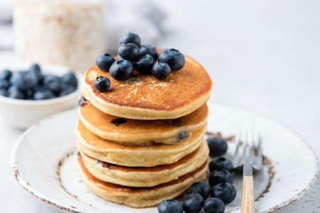 Stack of blueberry pancakes. Homemade corn pancakes with blueberries