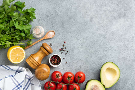 Vegetables and spices cooking background. Fresh ingredients for cooking healthy meal. Top view copy space for text