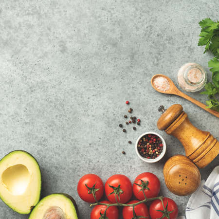 Spices and vegetables fresh cooking ingredients on concrete background, top view copy space for text recipe or menu