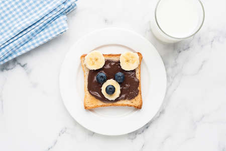 Teddy bear toast with chocolate spread, banana and blueberry. Kids food, childrens breakfast or lunch menu