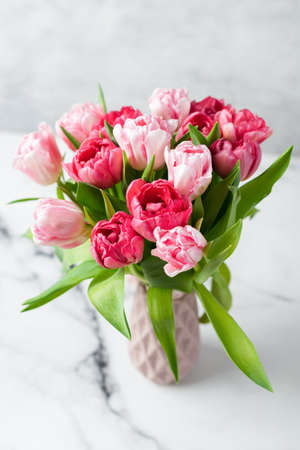 Bouquet of pink peony tulips in vase. Holiday flowers bouquet, wedding or 8 March concept