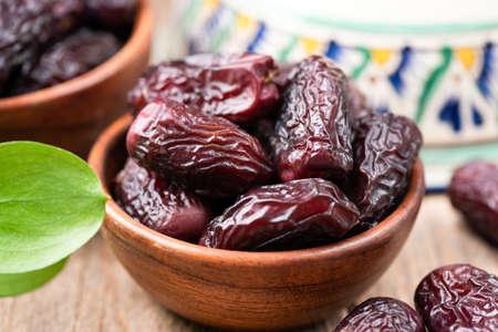 Dried dates in bowl. Tasty medjool dates. Arabic islamic food
