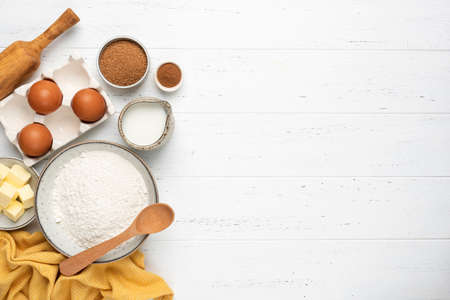 Ingredients for baking a cake cookies or sweet pastry on white wooden table background Stock Photo