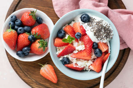 Curd cheese, cottage cheese or tvorog with fresh berries and yogurt. Healthy dairy product food, diet breakfast meal