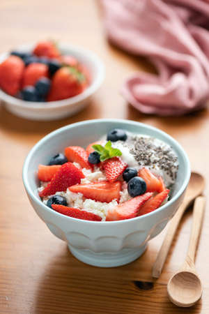 Healthy food bowl ricotta with strawberries and yogurt. Cottage cheese or tvorog