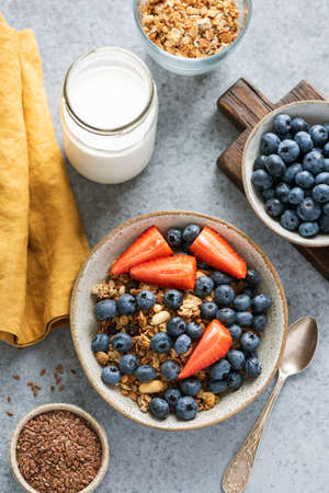 Breakfast bowl with berries and oat honey granola, top view. Concept of clean eating, dieting, sustainable lifestyle Stock Photo