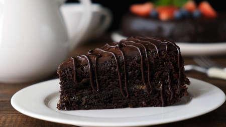 Slice of chocolate cake Zacher on plate, closeup view