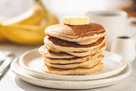 Buttermilk pancakes with knob of butter. Morning breakfast food Stock Photo
