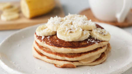 Gluten free banana pancakes with coconut flakes. Healthy diet breakfast food