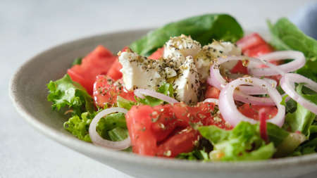 Greek salad with feta cheese in a bowl