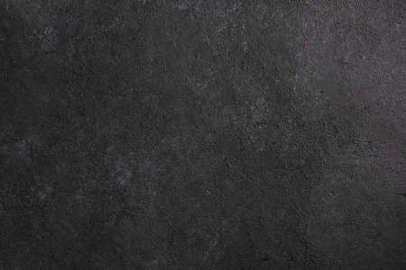 Black concrete background texture. Black slate