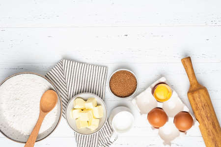 Baking cake or pastry or cookies ingredients on white wooden background. Top view ingredients for baking Standard-Bild