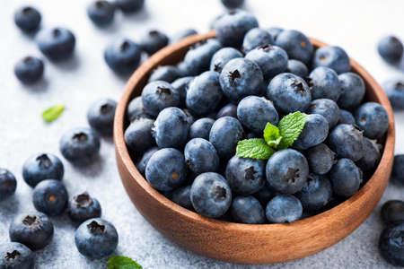 Pile of blueberries in a wooden bowl. Organic juicy blueberries Stock fotó