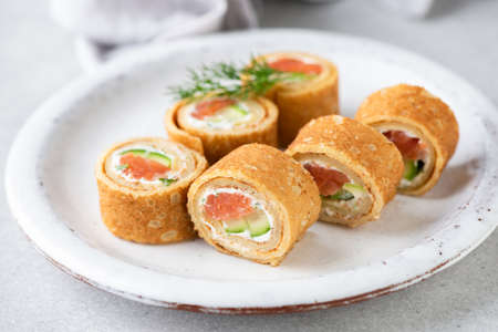 Crepe salmon rolls with herbed cream cheese. Appetizer party food