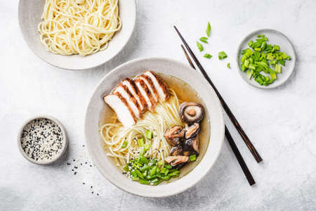 Chicken ramen noodle soup bowl. Asian cuisine food, noodle soup with chicken meat and shiitake mushrooms