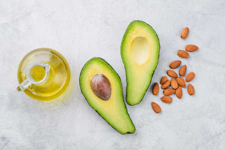 Avocado almond oil top view. Concept of clean eating, health care and body spa massage oil