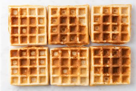 Belgian waffles texture isolated on white background. Six plain sweet home baked belgian waffles pattern
