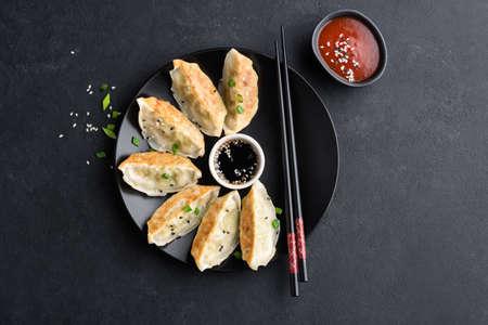 Asian food Gyoza or Jiaozi fried dumplings