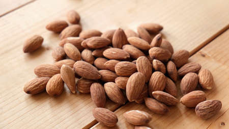 Group of almonds on wooden table