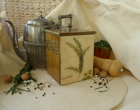Retro still-life with an old kettle and a box of dried herbs.