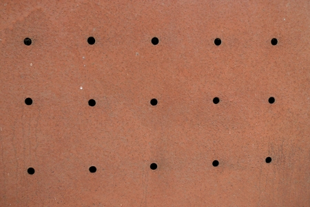 perforation: Rusty metal with perforation and corrosion background Stock Photo