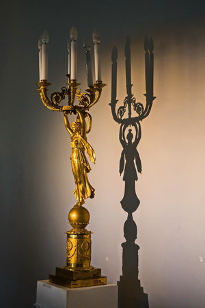 Antique chandelier and its shadow. Inside the interiors of the Pavlovsk Palace. Фото со стока