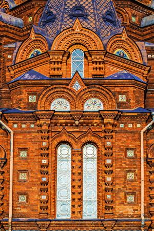 Fragments of masonry bricks on the facade of the religious buildings. Church of the Epiphany on Gutuevsky Island in St. Petersburg.