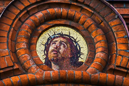 Mosaic inserts on the facades of the cult building. Church of the Epiphany on Gutuevsky Island in St. Petersburg.