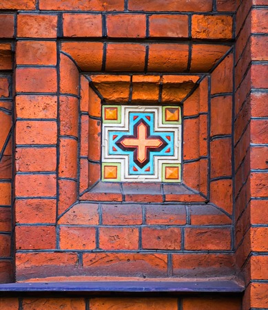 Tiles in brickwork a traditional technique in Russian architecture. Church of the Epiphany on Gutuevsky Island in St. Petersburg.