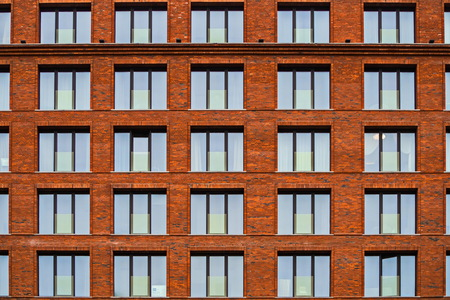 Brickwork facade of a residential building in the loft style. Modern buildings of St. Petersburg.
