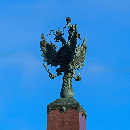 Three-headed eagle as a symbol of the Russian Empire. Trinity bridge in St. Petersburg.