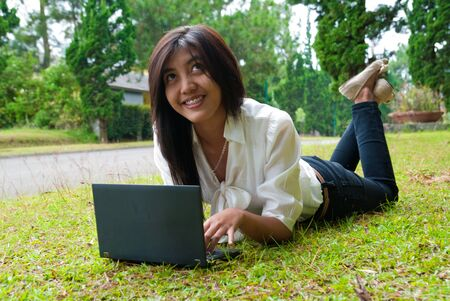 a female student relaxing in university's park