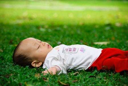 sleeping in a park Stock Photo