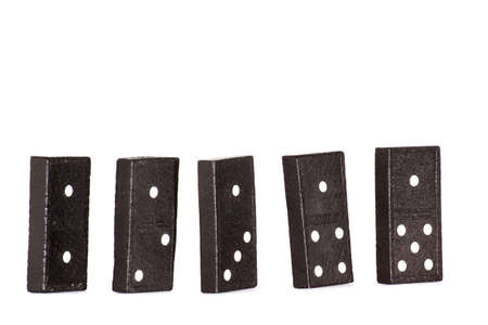 Piece of domino spread isolated on white background