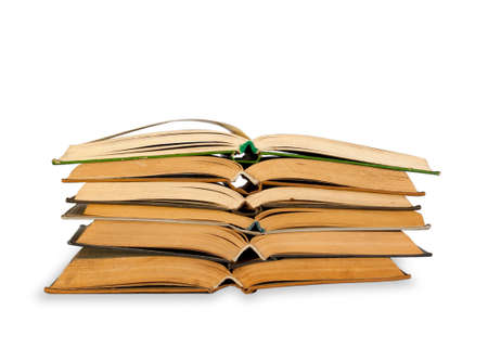 untidiness: A stack of old books on white background
