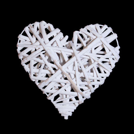 photo of object s: vine braided on a frame in the form of hearts isolated on a black background