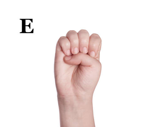 asl sign: Finger Spelling the Alphabet in American Sign Language (ASL). The Letter E Stock Photo