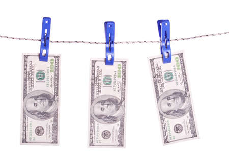 clothes pins: One hundred dollar bills hanging on a clothes pins Stock Photo