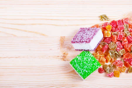marmelade: Marmelade candies isolated on wooden background