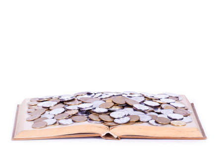 funding of science: A big open book with coins. Isolated on white. Stock Photo